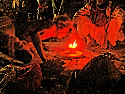 Invoking the Goddess with a lingam flame in Her dhuni
